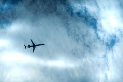 View of jet airplane flying in the distance royalty free stock images