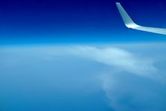 View of jet plane wing on the background of clouds Royalty Free Stock Images