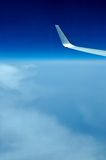 View of jet plane wing on the background of clouds Royalty Free Stock Photos
