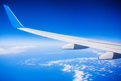 View of jet plane wing with blue sky Stock Photo