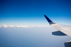 View of jet plane wing with clouds Stock Photography