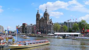 Saint Nicholas Church in Amsterdam, Netherlands. View from the jetty at Centraal Station on the city and Sint Nicolaaskerk, Saint Nicholas Church, Amsterdam stock video