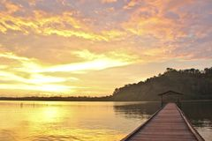 A view of a jetty during a golden sunset royalty free stock image