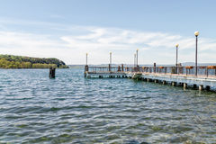 View of the jetty from the shore of Bracciano Lake Stock Images