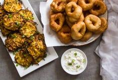 Hanukah Holiday: traditional food symbols: , `Sfinj ` - Moroccan Donuts and potato latkes. stock photo