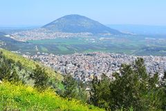 Jezreel Valley, biblical Mount Tabor and the Arab villages, Galilee, Israel. View of the Jezreel Valley, biblical Mount Tabor and the Arab villages at its foot royalty free stock photo