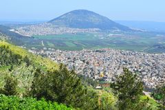 Jezreel Valley, biblical Mount Tabor and the Arab villages, Galilee, Israel. View of the Jezreel Valley, biblical Mount Tabor and the Arab villages at its foot stock images