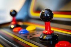 Joystick of a vintage arcade videogame - Coin-Op. A view of a joystick of a vintage arcade videogame - Coin-Op Royalty Free Stock Photos