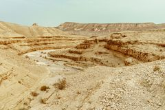 View on judean desert mountain, rock and blue sky near the dead sea in Israel. Infinity valley panorama of lone sand, hills and stones. Waterless middle east Royalty Free Stock Photo