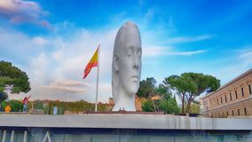 View Julia statute by Jaume Plensa. MADRID, SPAIN - APRIL 2: View Julia statute by Jaume Plensa at sunset HDR effect on April 2, 2019 in Madrid, Spain stock photography