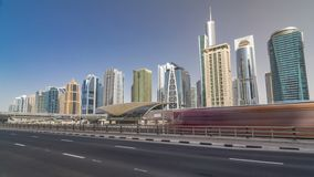 View of Jumeirah lakes towers skyscrapers and metro sration timelapse hyperlapse with traffic on sheikh zayed road. View of Jumeirah lakes towers skyscrapers stock footage