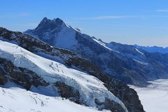 View from Jungfraujoch, Switzerland. Glacier with big crevasses. Part of the Aletsch glacier and mount Fiescher Gabelhorn. View from Jungfraujoch, Switzerland royalty free stock photography