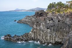 View of the Jusangjeollidae. Jusangjeolli are stone pillars piled up along the coast and is a designated cultural monument of Jeju. Island. Jusangjeolli Cliff stock photos