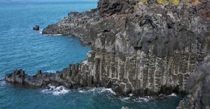 View of the Jusangjeollidae. Jusangjeolli are stone pillars piled up along the coast and is a designated cultural monument of Jeju. Island. Jusangjeolli Cliff royalty free stock photos
