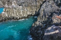 View of the Jusangjeollidae. Jusangjeolli are stone pillars piled up along the coast and is a designated cultural monument of Jeju. Island. Jusangjeolli Cliff stock photography
