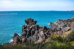 View of the Jusangjeollidae. Jusangjeolli are stone pillars piled up along the coast and is a designated cultural monument of Jeju. Island. Jusangjeolli Cliff stock image
