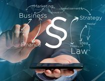 Justice and law symbol displayed on a futuristic interface with. View of a Justice and law symbol displayed on a futuristic interface with business terms Royalty Free Stock Photography