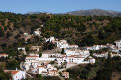 View of Juzcar, Andalusia, Spain. Village surrounded by trees and mountains, Juzcar, Serrania de Ronda, Malaga Province, Andalusia, Spain, Western Europe Stock Photo