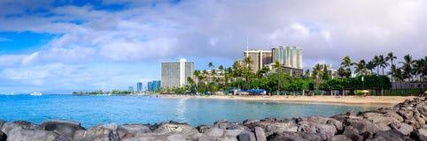 View of the Kahanamoku beach with hotels building and rainbow, Honolulu royalty free stock photo