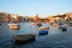 The view of the Kalkara bay in the sunset light, Malta. The view of the Kalkara bay between Birgu and Kalkara peninsula with the St Joseph church on the Royalty Free Stock Image