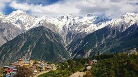 View of Kalpa village and Kinnaur Kailash sacred peak 6050 m at sunrise. Stock Photo