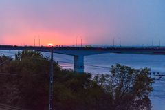 View of Kama river and Communal bridge in Perm, Russia. View of Kama river and Communal bridge on sunset. Perm, Russia Stock Image