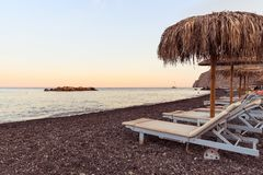 Kamari beach - Santorini Cyclades island - Aegean sea - Greece. View of Kamari beach - Santorini Cyclades island - Aegean sea - Greece stock image