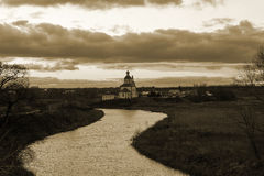 View of the Kamenka river and the Church at sunset in late autumn. Suzdal. Russia. royalty free stock images