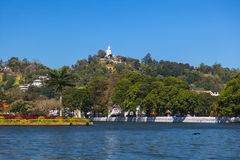 View on Kandy lake and big Buddha on top of the hill Stock Image