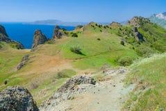 View from Karadag volcanic mountain range to Meganom cape Stock Photo