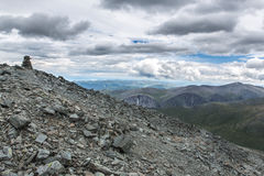 View from Karaturek mountain pass in cloudy weather. Karaturek is the most difficult mountain pass in Altai mountains. It could be passed on foot or on Royalty Free Stock Image
