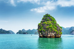 View of karst isle on blue sky background in the Ha Long Bay Stock Images