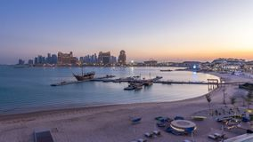 View from Katara Beach day to night timelapse in Doha, Qatar, towards the West Bay and city center. View from Katara Beach day to night transition timelapse stock footage