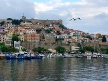 View of Kavala Fortress and town hiuses in the daylight with a seagull royalty free stock photo