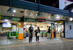 View of Kawaguchi train station at night. People at Kawaguchi train station in Saitama, Japan stock images