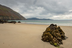 View from Keem beach on a cloudy day. View from Keem beach, Co. Mayo on a cloudy day stock image