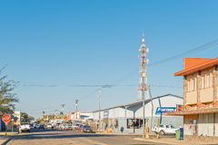 View of Keetmanshoop with businesses and microwave telecommunica. KEETMANSHOOP, NAMIBIA - JUNE 13, 2017: A late afternoon view of Keetmanshoop with businesses Stock Images