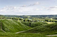 View of Kernavė mounds from Kernavė town. Kernavė mounds are located on the southern outskirts of Kernavė town Lithuania, on the right bank of the Neris Royalty Free Stock Photography