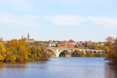 A view on Key Bridge and historic buildings across Potomac River in autumn. Stock Photos