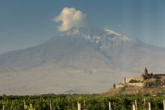 Grape field in Ararat valley. View of Khor Virap and Mount Arara. View of the Khor Virap monastery and Mount Ararat. In the foreground grape plantations Royalty Free Stock Image