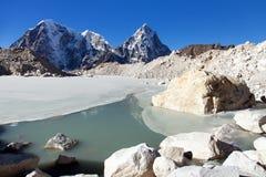View from Khumbu Glacier Nepal Himalayas mountains. View from Khumbu Glacier, Lake on glacier, Mounts Arakam Tse, Cholatse, and Tabuche Peak, Khumbu valley Stock Photos