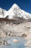 View of Khumbu glacier with lake and Pumori peak Royalty Free Stock Photography