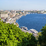 View of Kiev city Podil District with River Port. Travel to Ukraine - view of Kiev city Podil District with River Port and Dnieper River from Volodymyrska Hill Stock Photos