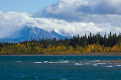 View of Kluane Lake and snow capped St. Elias mountains Royalty Free Stock Image