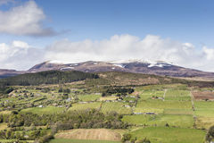 View from Knockfarrel hill to Ben Wyvis in Scotland. View from Knockfarrel hill over the Braes of Strathpeffer in Scotland royalty free stock photography