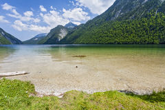 View of Konigsee. Bavaria. Germany. Crystal clear lake in the background of mountains Stock Photos
