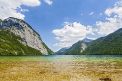 View of Konigssee. Bavaria. Germany. Crystal clear lake in the background of mountains Royalty Free Stock Photo