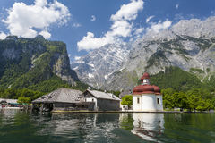 View from Konigssee.Germany. Church by lake on the background of mountains Stock Photo
