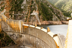 View of the Kouga Dam wall with no water flowing over Stock Photo