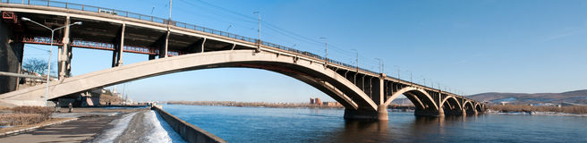 View on Krasnoyarsk and bridge over the river. View on Krasnoyarsk and bridge over the Enisei river. Siberia, Russia Royalty Free Stock Photos